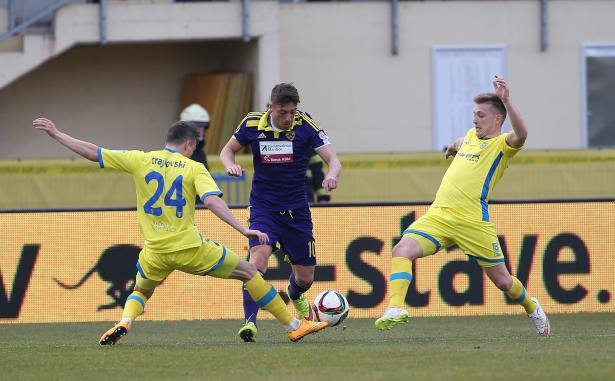 Ibraimi tries to dribble past Dejan Trajkovski