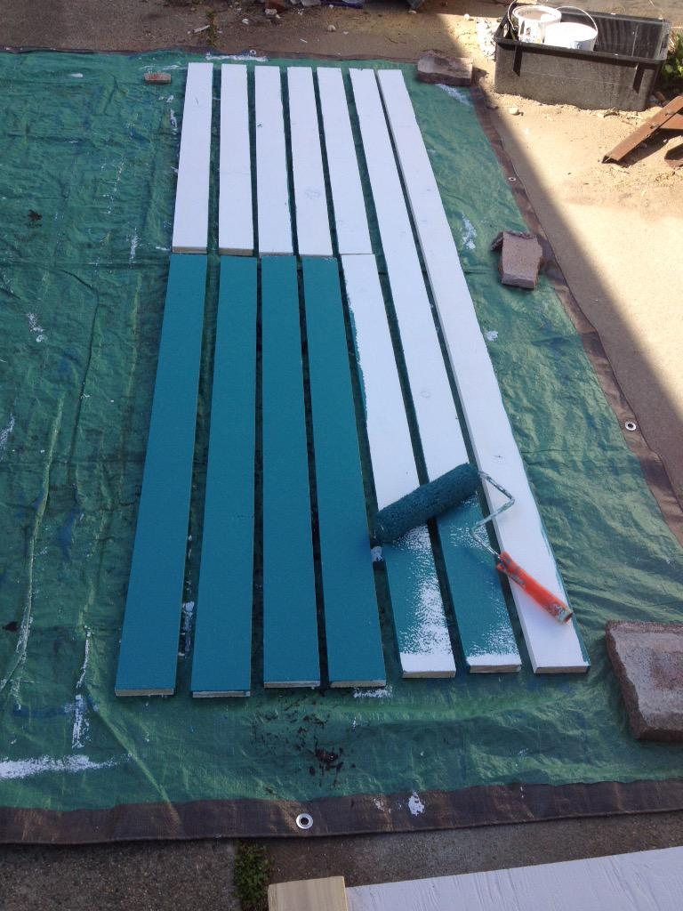 Back to #KensGarageDoor: painting the 1x4 trim boards. This dark green color will need two coats. First coat goes on: http://t.co/izCoEoXtwV