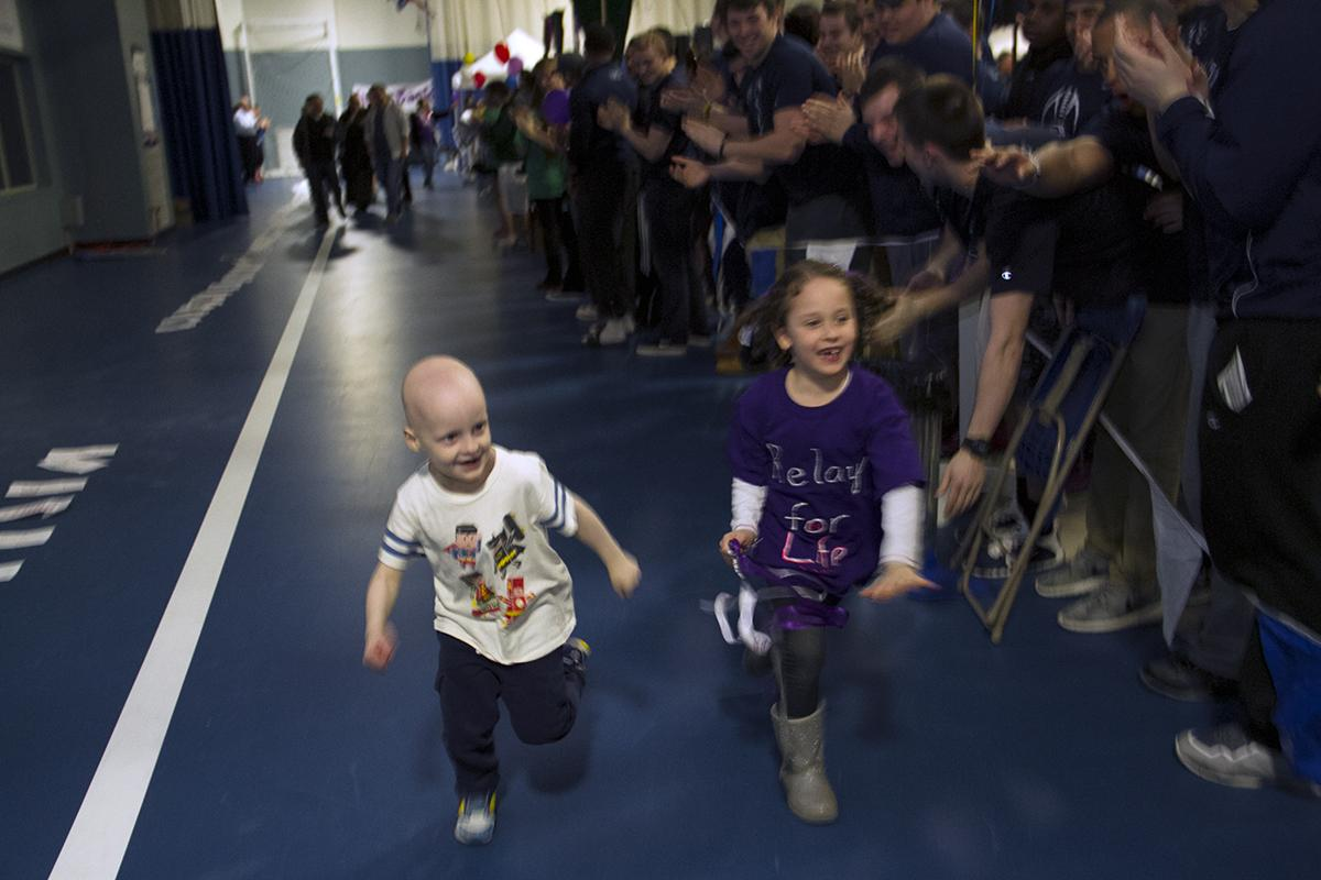PHOTO: Two honorary Grand Marshal cancer survivors led the Survivor's Lap during tonight's #AnselmianRelay! http://t.co/pMsHTJ20g2