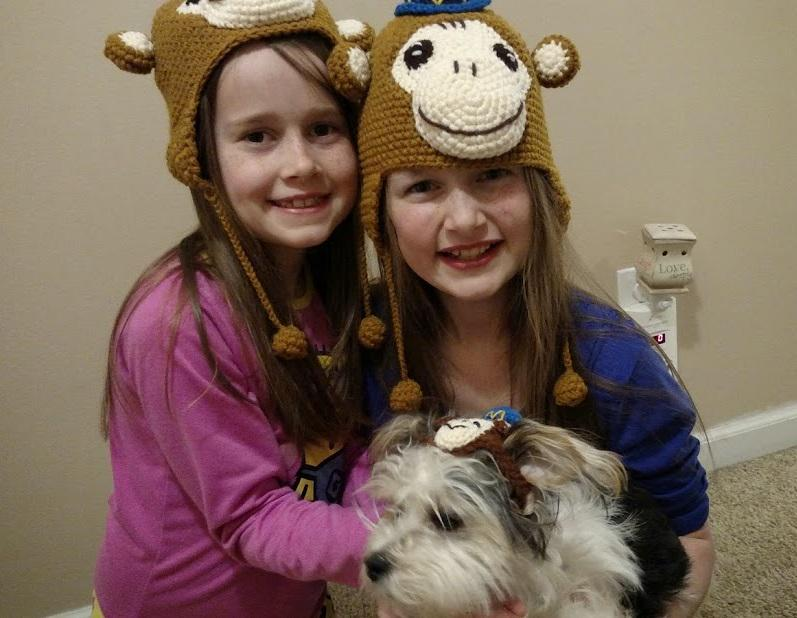Two cute girls (and a puppy!) in their new @MailChimp hats. #wcatl http://t.co/KWUKRSggtl