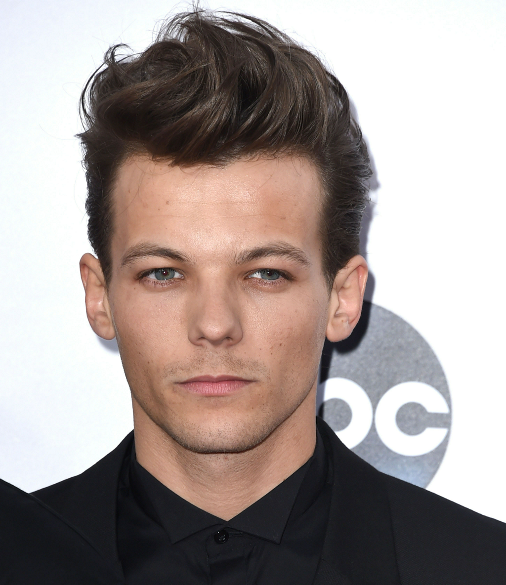 One Direction's Louis Got Into a Twitter Fight With Zayn's New Producer http://t.co/7Zszh4I9DT http://t.co/nfId6BgfNY