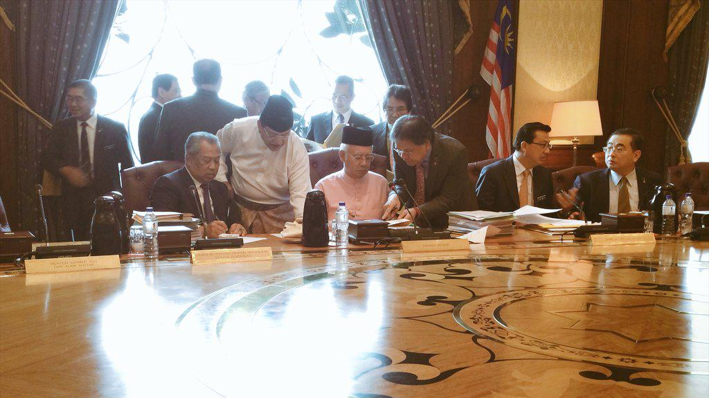 Managed to capture post-cabinet meeting happenings just now. Cabinet members are behind him!