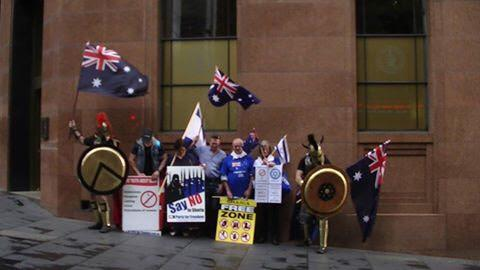 Are these people for real? Roman costumes? The #ReclaimAustralia gathering in Martin Place today. Enjoy the rain http://t.co/EkvRY2ay9U