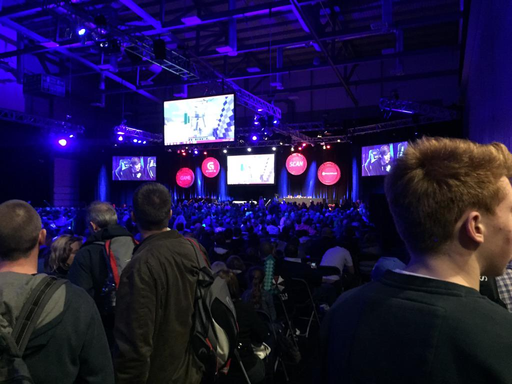 The Main Hall at Insomnia54. A YouTuber is on stage yelling at things for seemingly no reason at all.