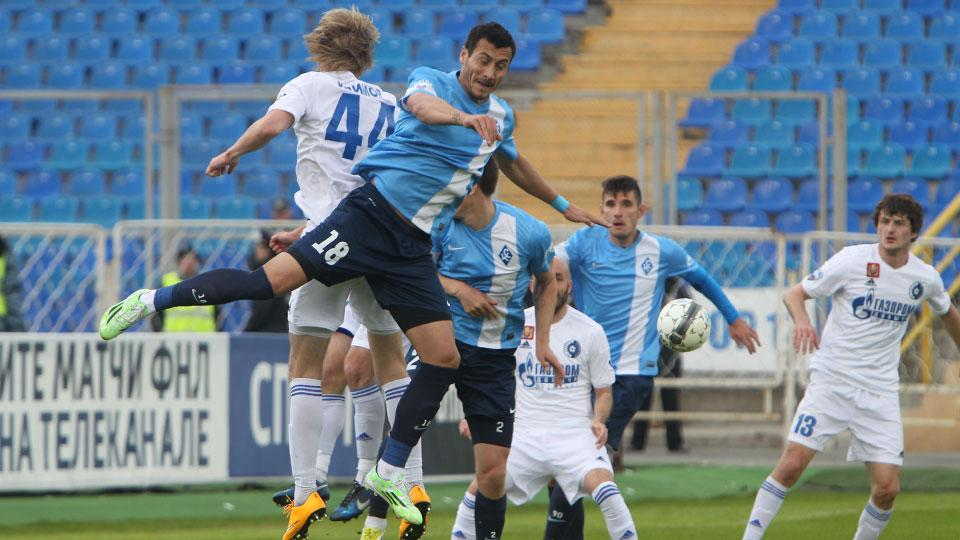 Jahovic challenges for the ball