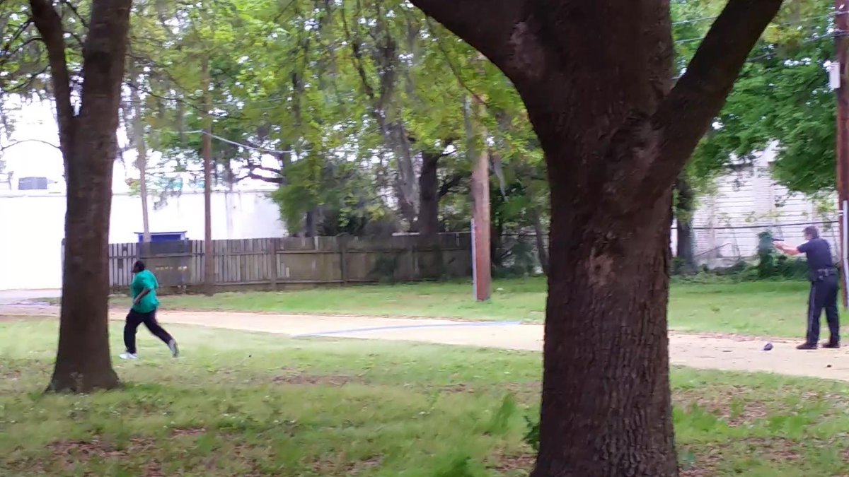 A screen shot from the video that shows the shooting death of #WalterScott