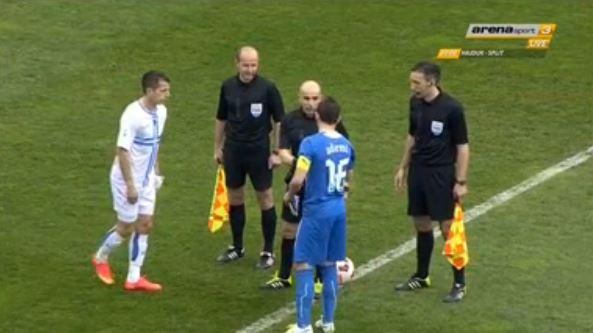 Ademi chats with the referees