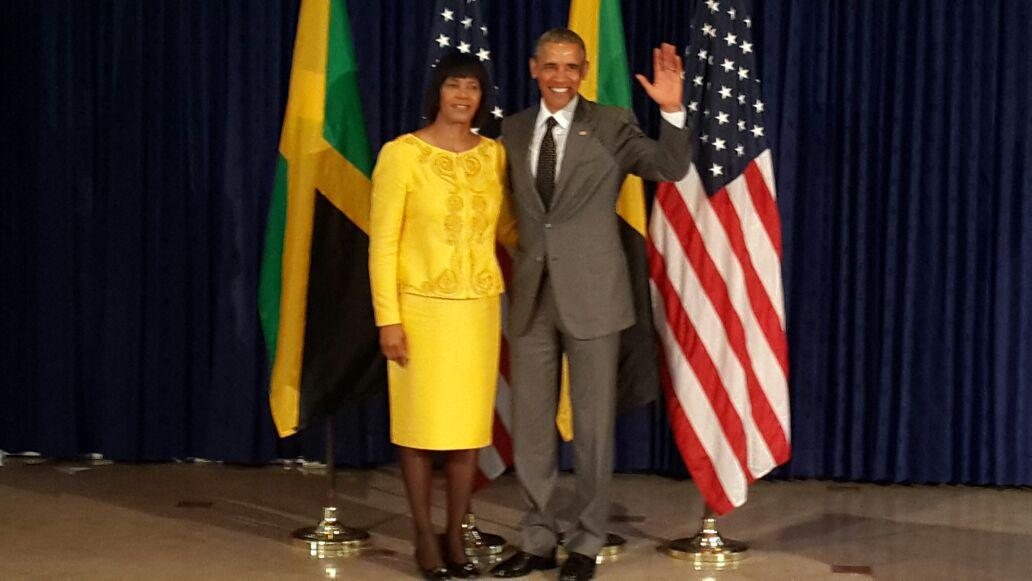 President Barack Obama arrives at the Office of the Prime Minister & welcomed by Prime Minister Portia Simpson Miller http://t.co/3mwpMjuIOF