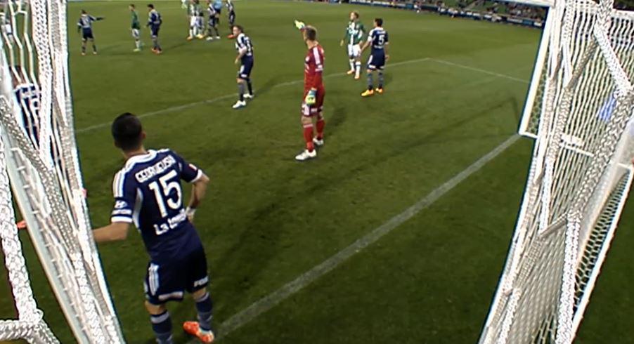 Georgievski protects the near post on a corner kick