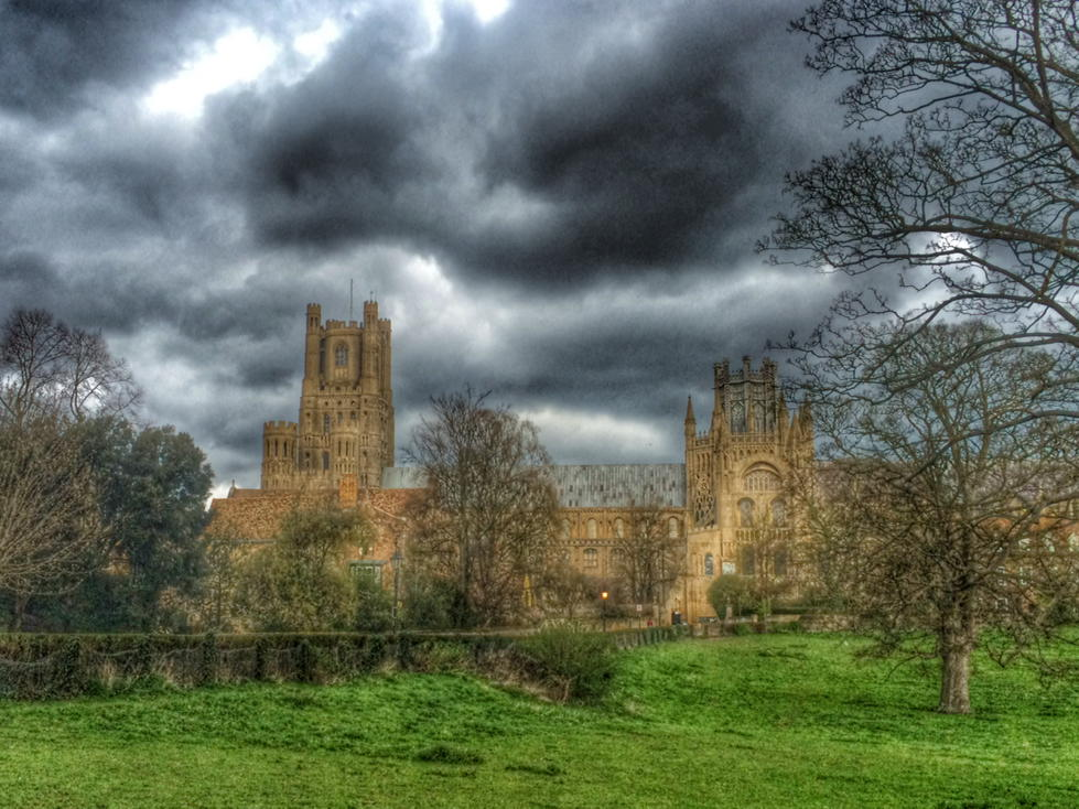 Storm clouds dominate the sky above @Ely_Cathedral this afternoon, but the slithers of fenland sunlight adds drama http://t.co/B5zr36K1FW