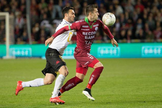 Trajkovski battles for the ball