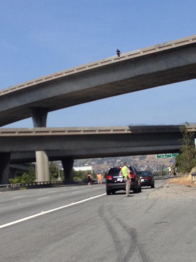 Traffic for days... Guy on edge of overpass threatening to jump... 280/10 San Jose http://t.co/oh4QxaNd1q