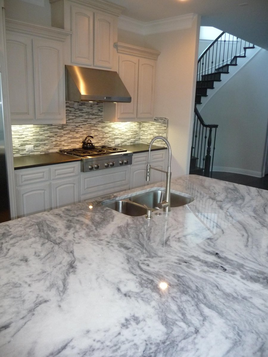 Dfw granite on twitter beautiful glacier white granite and black pearl leather granite make for a stunning kitchen http t co 64rsyzwtki