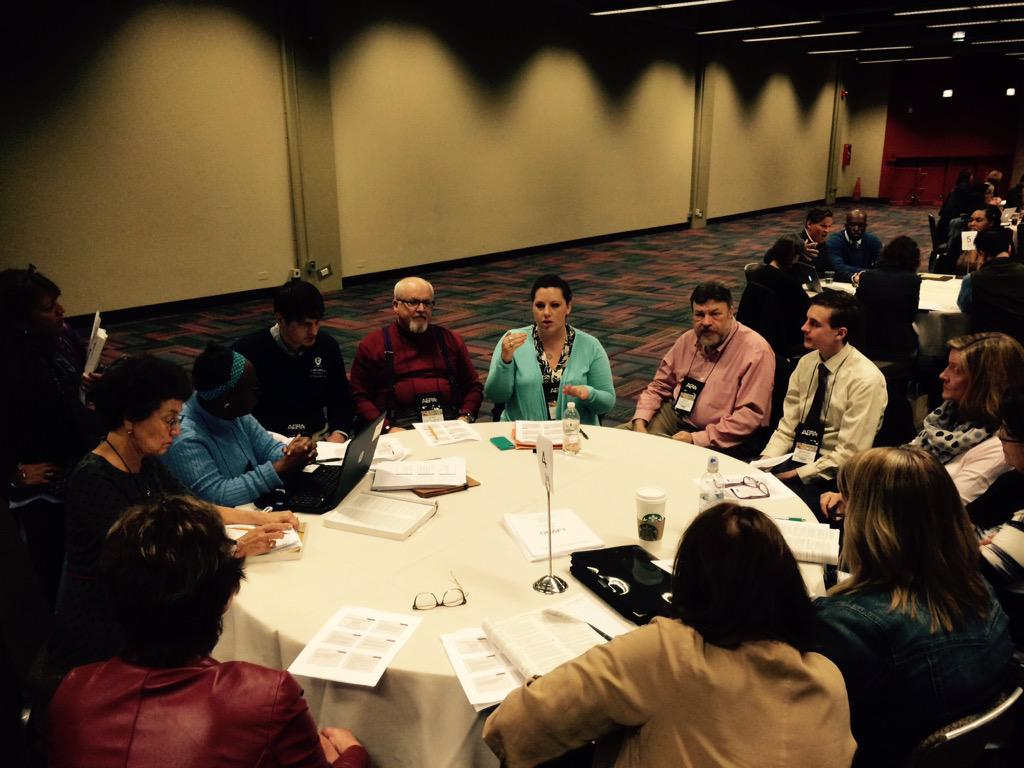 This is what a fully engaged round table session looks like! @AERA_EdResearch #AERA15 http://t.co/1oUjMbI18r