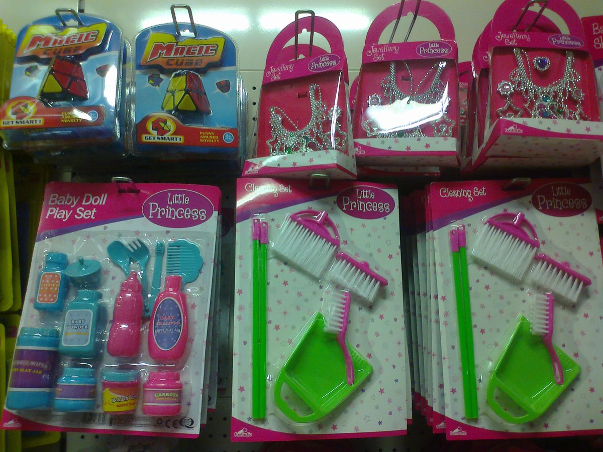 Toy shelves - pink princess dustpan and brush set.
