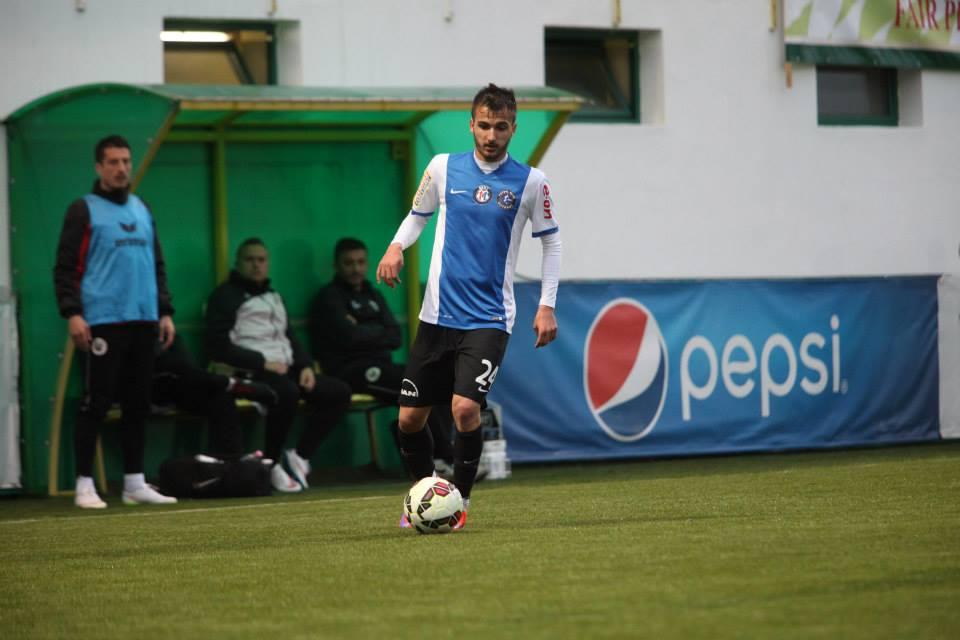 Nikolov controls the ball
