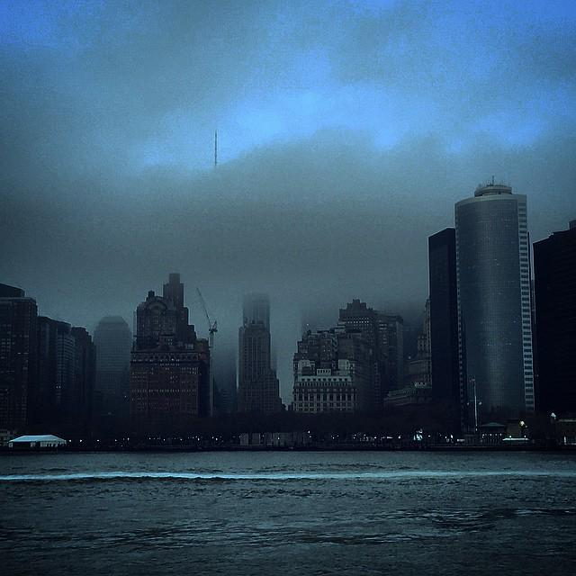 Fog envelops Manhattan skyline, save One World Trade spire #statenisland #nyc http://t.co/67kPJ5gsTd
