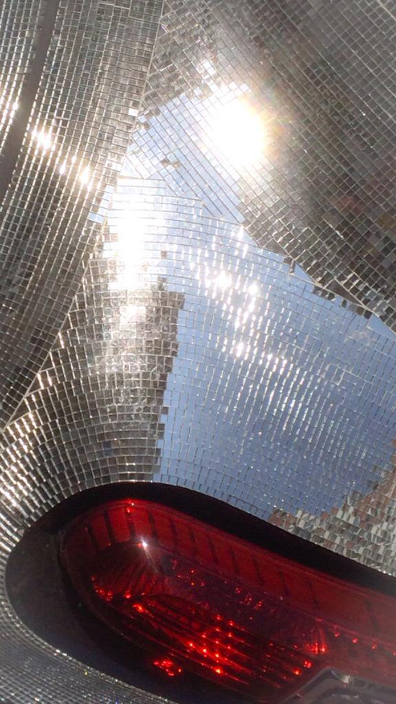 Corner of a parked up, blingy  little Smart car. Like a Reliant Robin created by Damian Hirst http://t.co/GPp5t5AH0I