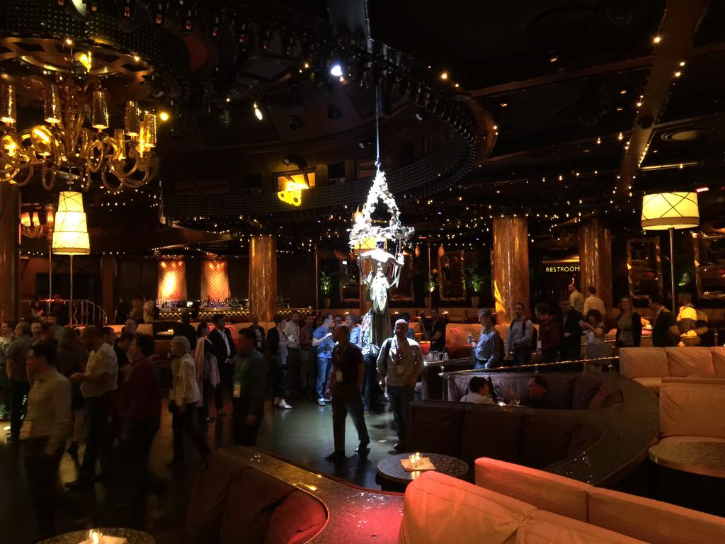 JoshuaSWarren: There's a waitress hanging from the ceiling pouring drinks. This will truly be a legendary party. #ImagineCommerce http://t.co/zGecHjsAz4