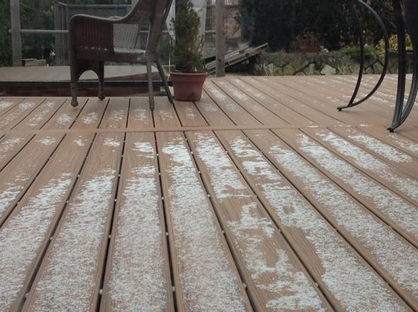 dusting of snow on a deck