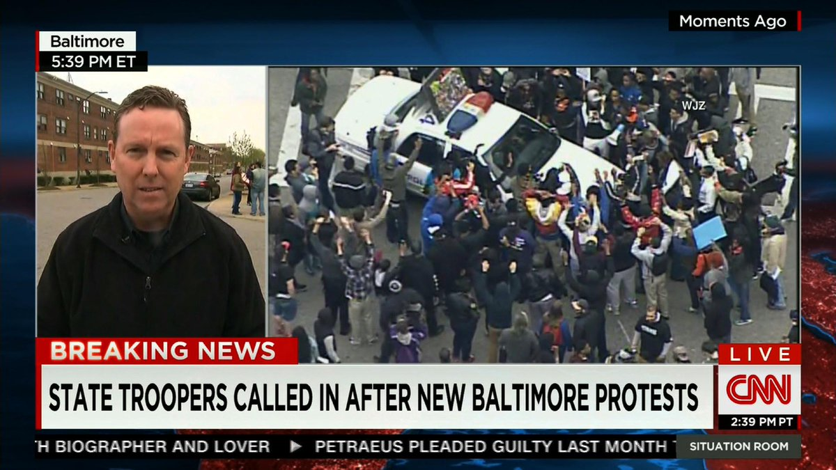 #FreddieGray protesters surround police cruiser in Baltimore