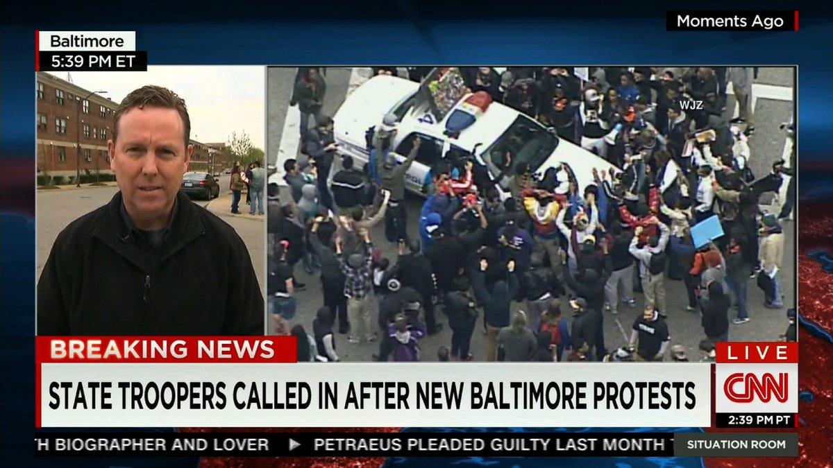 #FreddieGray protesters surround police cruiser in Baltimore