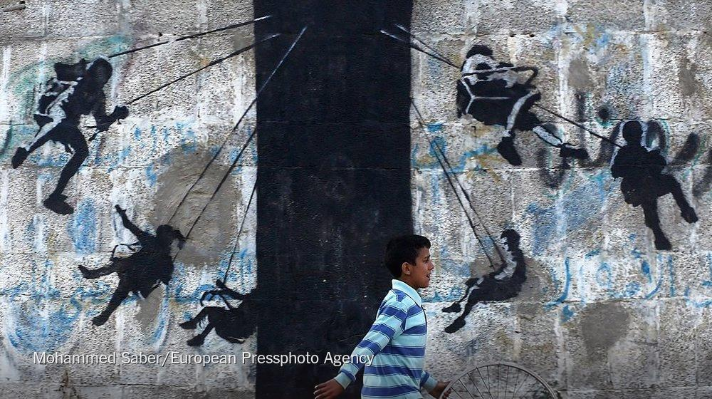 """@nytimes: Banksy left his mark in Gaza http://t.co/Zq1kLs5WvY http://t.co/UdjyfOVLR0"""