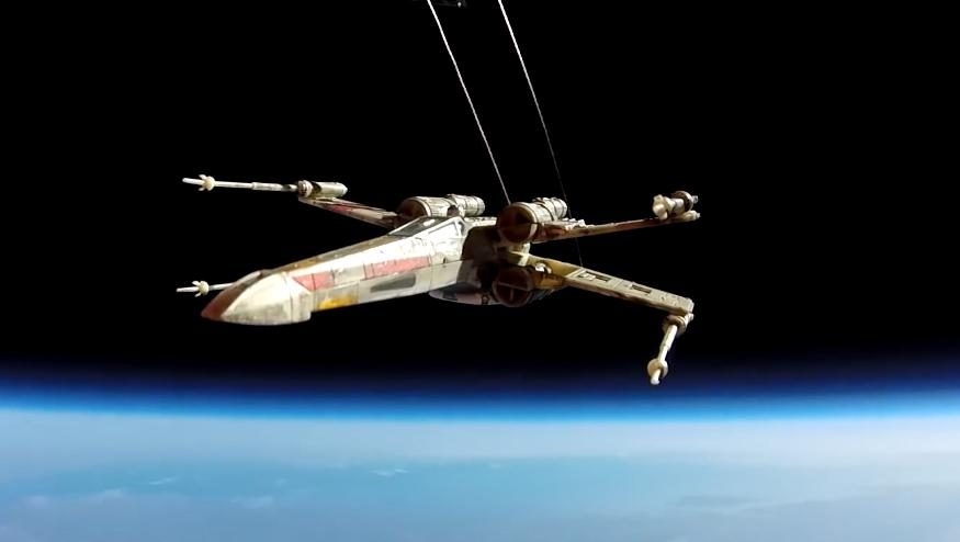 An actual X-wing. Flying through actual space. Amazing. http://t.co/c6M49IaCB8 http://t.co/Un4yWAJrBY