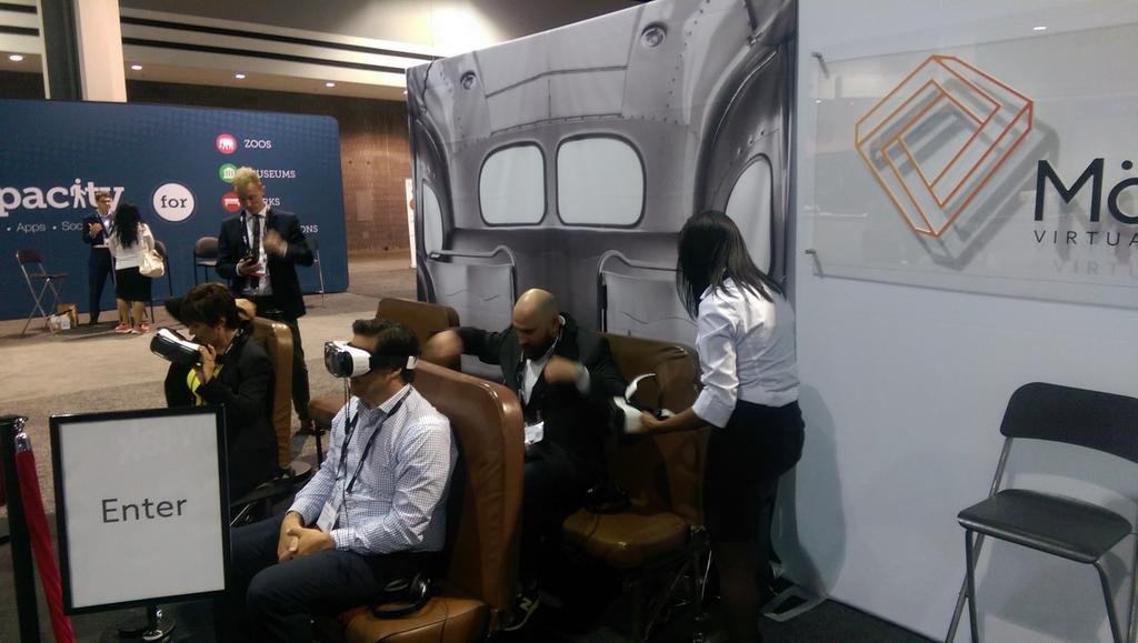 People try on virtual reality devices to see what it was like being on the bus as Rosa Parks.