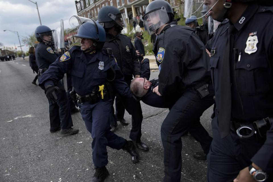 Police in riot gear clashed with teenagers Monday following the funeral of Freddie Gray. http://t.co/NaJSFtHz9a http://t.co/jT4WrDreCu