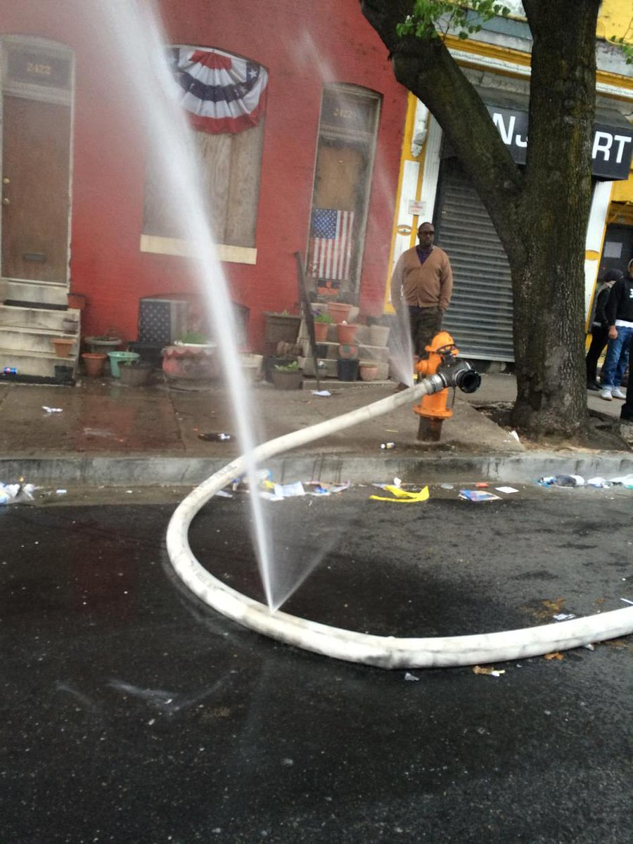 Protesters cut holes in fire hose to hinder firefighters putting out cvs building fire #cnn #cnnlive http://t.co/3SByzXcVEn