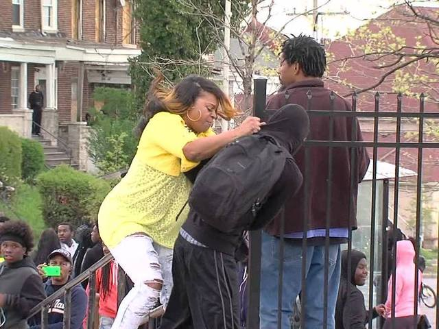VIDEO: Mom beats child for throwing rocks at Baltimore Police http://t.co/s1tPNURRks   #BaltimoreRiots