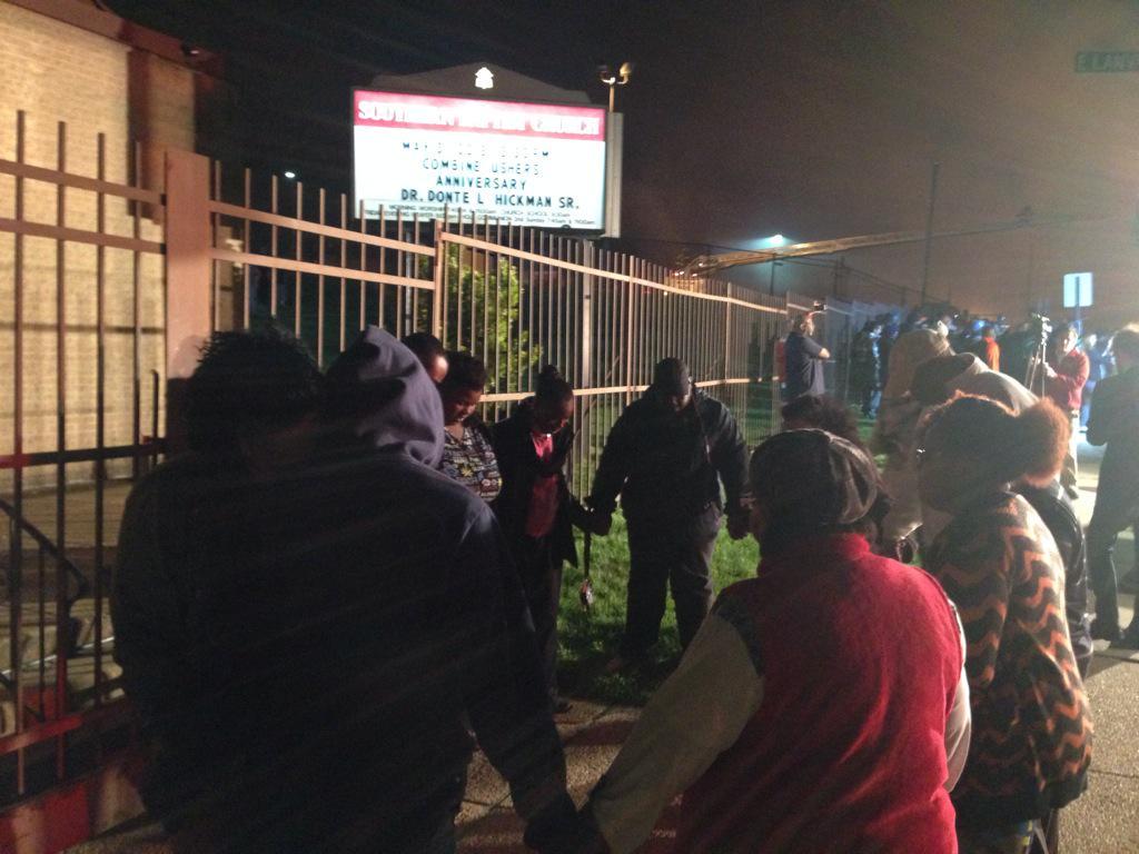 Worshippers pray near fire. http://t.co/XRgarZdDqs