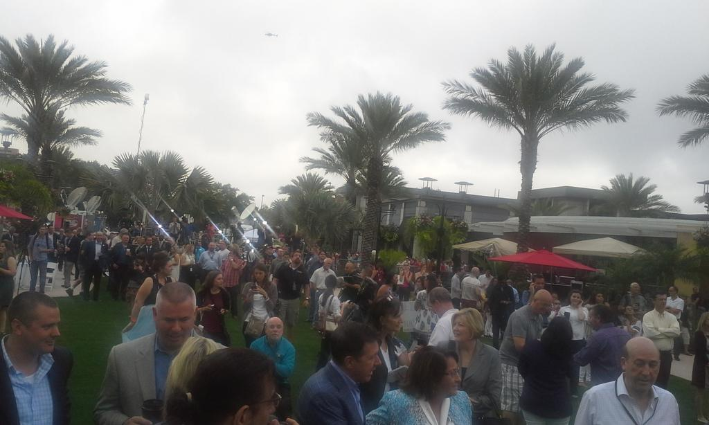 The crowd waiting for @theorlandoeye #WalkTheWheel. You can see the weather is moving in. http://t.co/8wjNoHeHUN