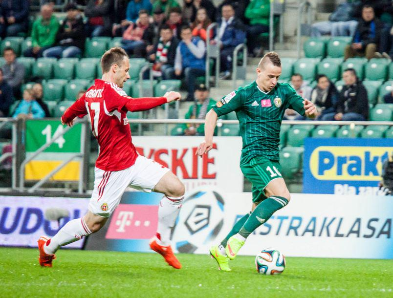 Stjepanovic (L) defends his marker