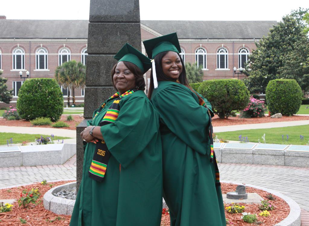 A standing ovation for 62yr. old Cathy Williams and her granddaughter, Chelsea Washington graduating together! http://t.co/GSrRKtJwxJ