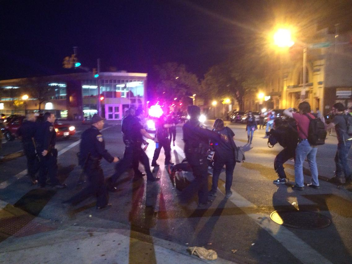 Police spray shouting man in face at close range, then drag him 2 ground by his hair #Baltimore http://t.co/LvD9mY2HEg