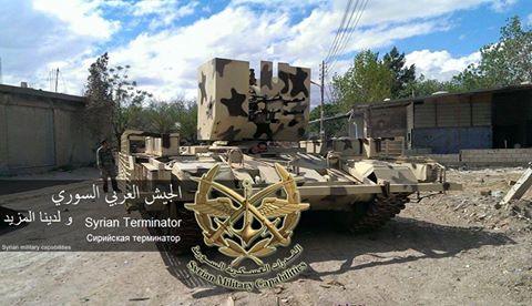 الوحش الفولاذي لدى قوات الجيش السوري .......الدبابه T-72  CEL13L7WIAAmaQU