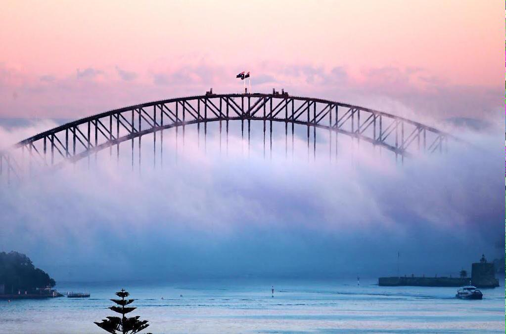 Sydney blanketed by a thick layer of fog this morning. This magic shot taken by @johngrainger11 for @dailytelegraph. http://t.co/NY2T7jYRa5