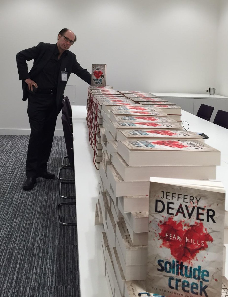 "Just signing a ""few"" copies of Solitude Creek at  Hodder & Stoughton's new headquarters in London!  @HodderBooks http://t.co/lsdur7SOWn"