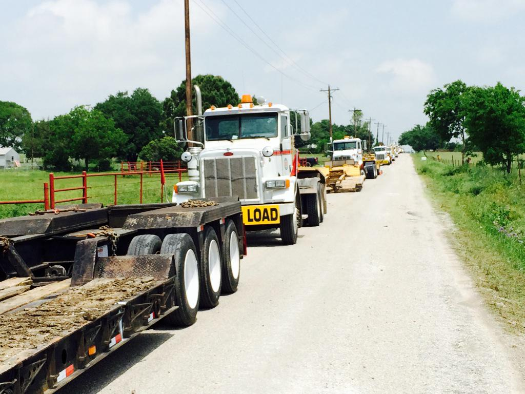 Cooke County : Traffic jam heavy equipment build roads reach