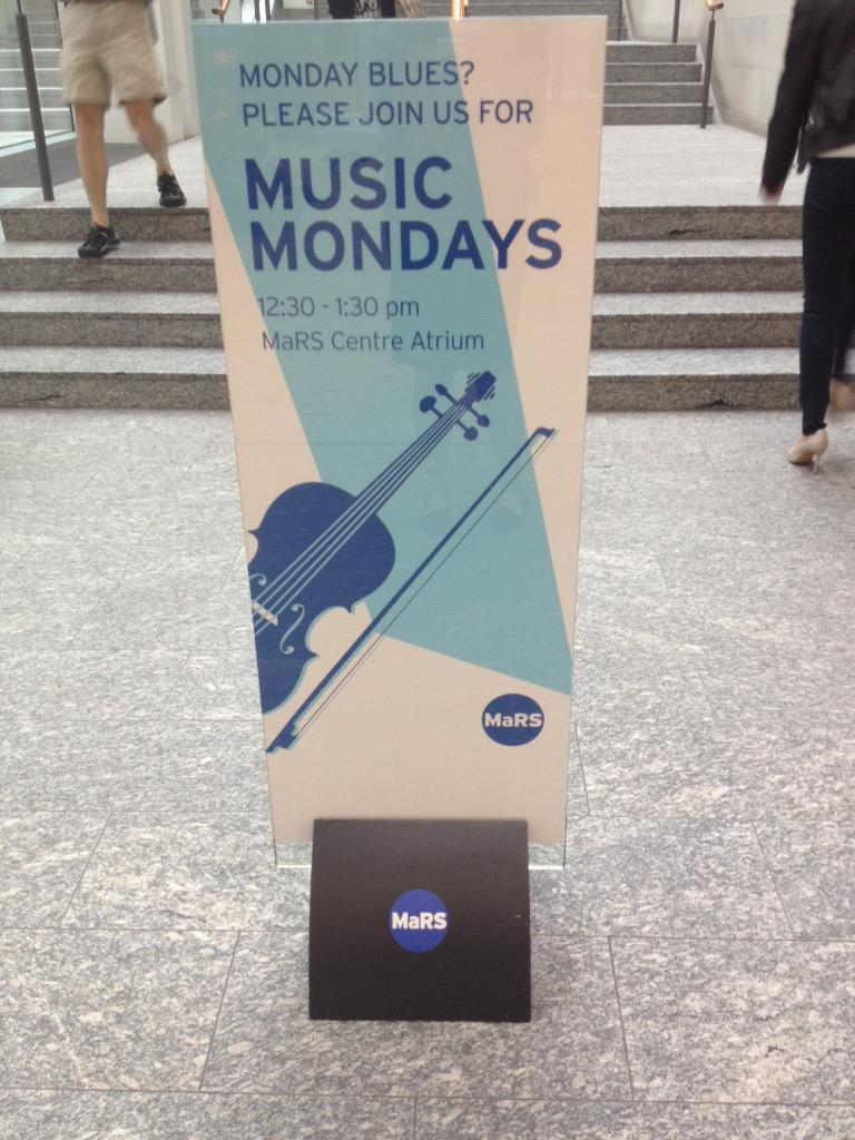 A sign in the MaRS Discovery District advertising Music Mondays.