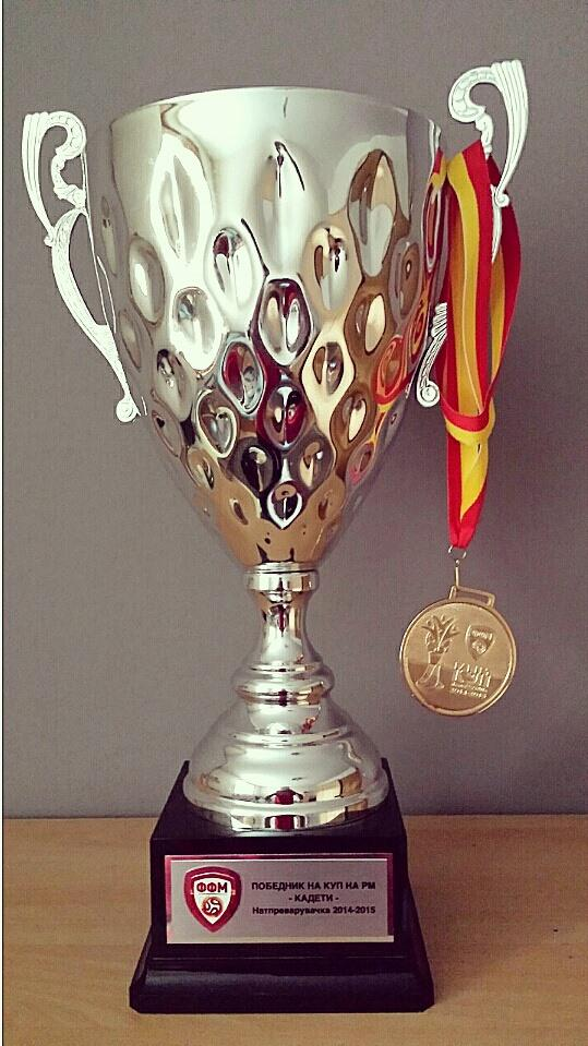 A closer look at the trophy and medal