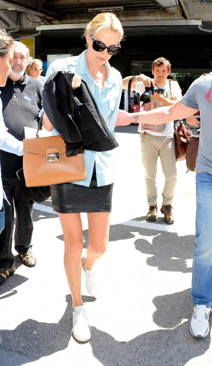 PRADA on Twitter: \u0026quot;Charlize Theron carries the Prada hand-stitched ...