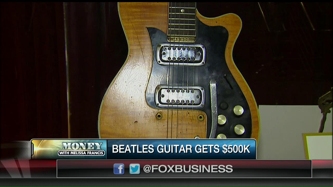 eba79a99223 This guitar played by the Beatles' George Harrison sold for $500k!