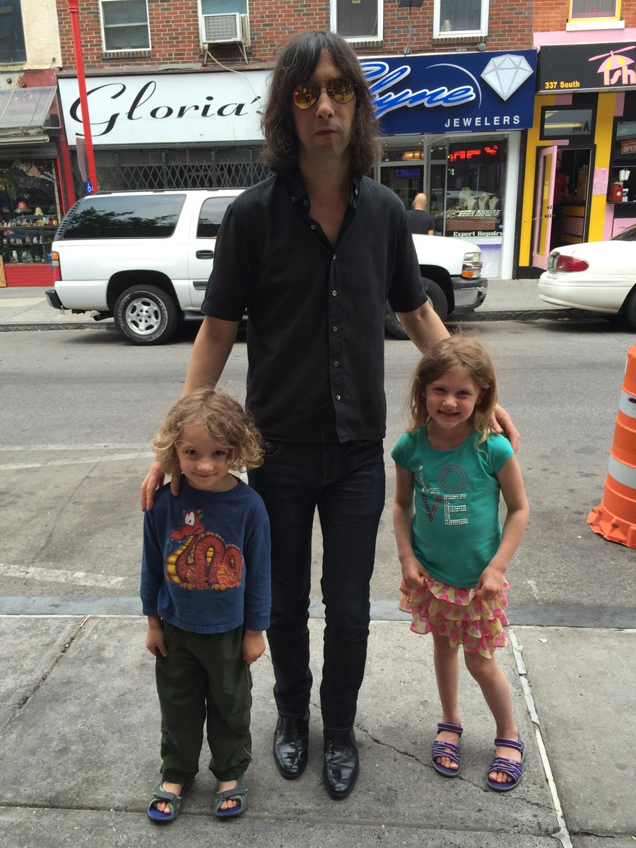 Met members of Primal Scream on the street. Bobby was kind enough to take a photo with his youngest fans http://t.co/wBIo7hphDz