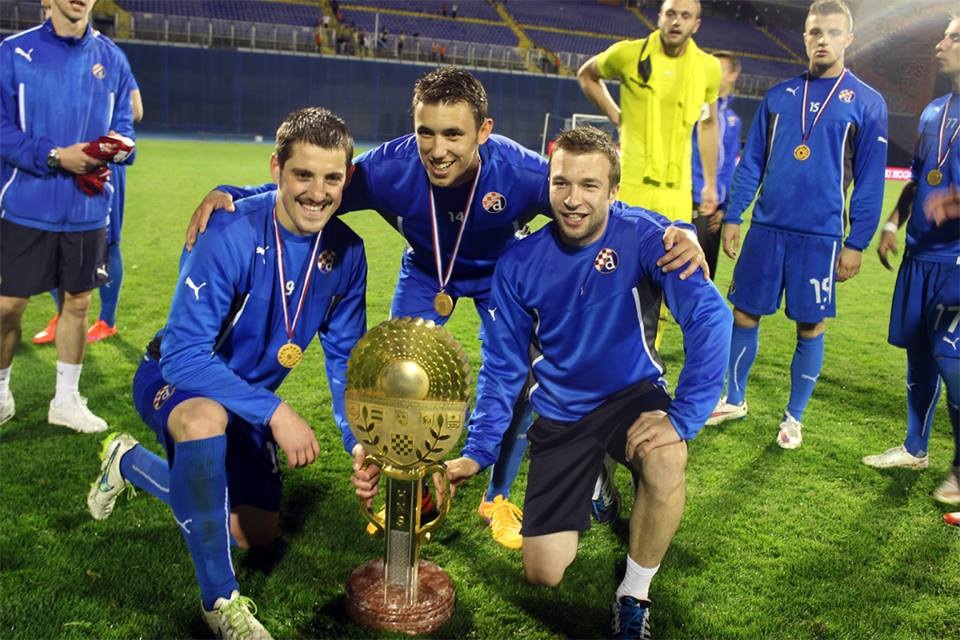 Ademi with the cup trophy