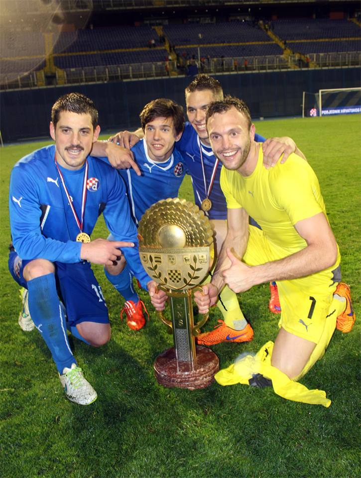 Ademi and teammates with the trophy