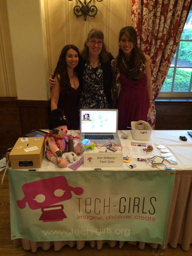 Kim Wilkens (middle) at Tech-Girls table with volunteers.