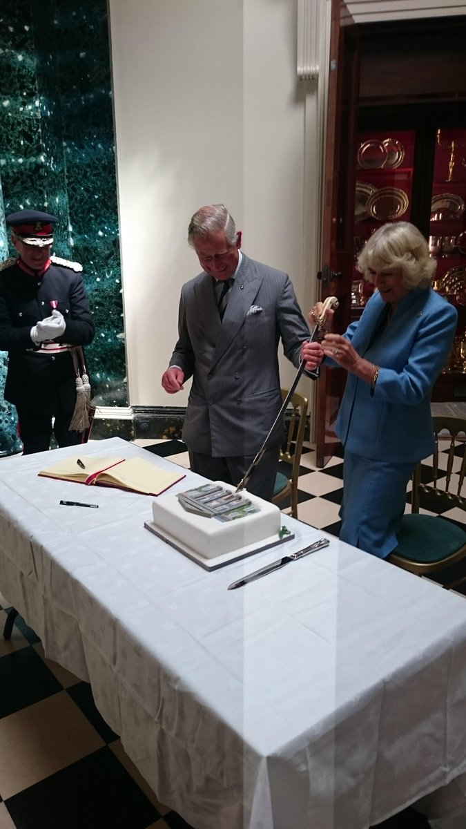 TRH cut a cake @NTmountstewart to commemorate the re-opening of Mount Stewart House @NationalTrustNI #RoyalVisitNI http://t.co/zwmLWuMGmb